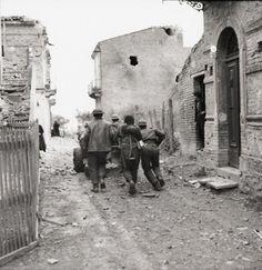 Canadian troops moving an anti-tank gun during street fighting in Ortona