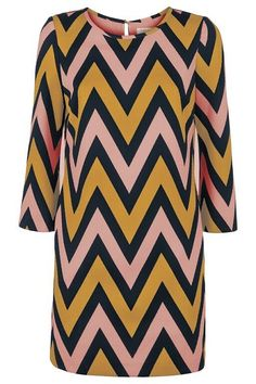 Tunic style dress in mustard pink and navy zig zag pattern. Round neck with three quarter length sleeves. Above knee length. Pocket detail in side seams. Occasion Wear, Special Occasion Dresses, The School Run, Zig Zag Pattern, Race Day, Pocket Detail, Put On, Fashion Boutique, Mustard
