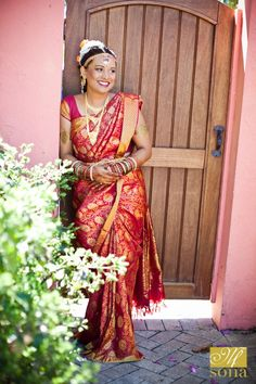 A happy bride posing in our courtyard garden area before her wedding - photo by #BethInsalaco