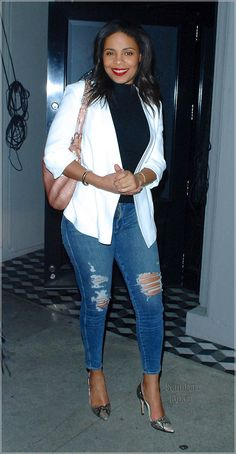 Sanaa Lathan in distress jeans and blazer