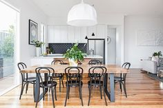 "Rachel and Marty's modern-classic Victorian cottage renovation:Rachel loves the way the timber flooring continues up the back of the kitchen bench. It matches the dining table perfectly.  Bentwood **chairs** in Black from [Connect Furniture](http://connectfurniture.com.au/|target=""blank"")."