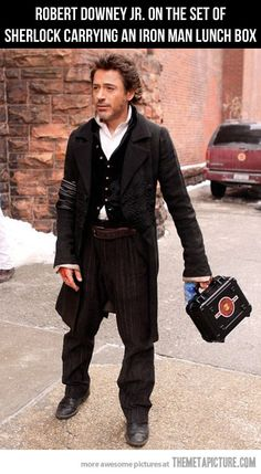 "Robert Downey Jr on the set of ""Sherlock Holmes"" carrying an Iron Man lunchbox. What is it about this man? He's funny and hot! Sherlock Holmes, Watch Sherlock, Robert Downey Jr., Susan Downey, Dc Movies, Movie Tv, Movie Scene, Iron Man, Hilarious"
