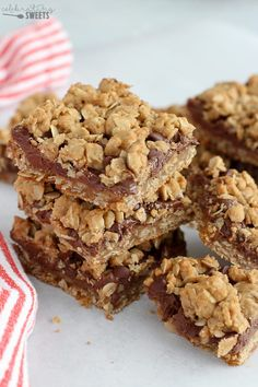 Nutella Cookie Bars - Buttery brown sugar oatmeal cookie bars filledwith Nutella chocolate hazelnut spread and chocolate chips. These easy Nutella Bars bars require no mixer, and the crust and topping is made from the same mixture. #nutella #bars #dessert #baking #chocolate