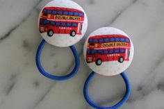 www.babyraindrops.etsy.com. London Double Decker Bus pony tail holders make adorable party favors by Baby Raindrops, $5.95.