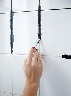 "How to DIY dye your white grout black! Such an easy DIY that can completely transform your bathroom or kitchen -- and no more dirty grout! Get inspired to make your own bathroom makeover happen with the tips and ideas from ""A Contractor-Free Bathroom Renovation You Wont Believe!"" on the  One Kings Lane Style Guide!"