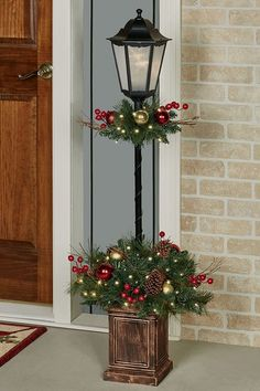 A vision of timeless tastes, the Holiday Indoor/Outdoor Lighted Lamp Post Topiary illuminates your Christmas spirit. Perfect indoors or on a covered porch! #outdoorlights #diychristmas Christmas Garden, Christmas Porch, Rustic Christmas, Christmas Wreaths, Christmas Crafts, Christmas Ornaments, Christmas Topiary, Christmas Lamp Post, Handmade Christmas