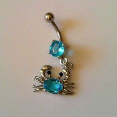 A way to label a loose girl  her raging case of crabs. - vBlue CZ Dangling Crab belly button ring