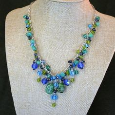 Fair Trade Green & Blue Multi-bead Necklace - India — This popular necklace features blue and green glass beads, smooth and faceted. On a silver-toned brass chain. Handmade by low-income women artisans in New Delhi, India, who are part of a fair trade organization.
