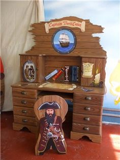 Going to see if I can repurpose a desk we already have to look like this for Ethan's pirate room.
