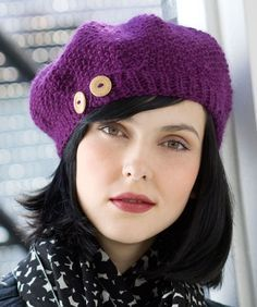 Buttoned Beret. I like the shape of this. I would knit it up in charcoal and put a crocheted flower instead of the buttons