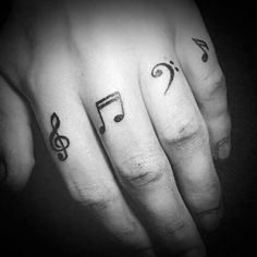 Guys Simple Music Notes Tattoos On Fingers