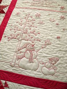 Beautiful machine quilting on this hand stitched Winter Wonderland Quilt.