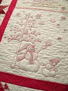 Beautiful machine quilting on this hand stitched Winter Wonderland Quilt.