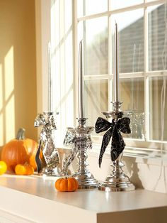 Easy Candle Decor    Wrap lengths of Halloween ribbon around candlesticks, tie into bows, and insert matching tapers.