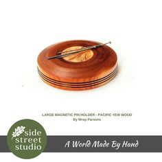 LARGE MAGNETIC PIN HOLDER - PACIFIC YEW WOOD  Local hardwoods combined with powerful rare earth magnets make these a must for serious sewers and quilters. Will hold pins, needles and scissors securely  Hand made on Vancouver Island. Side ~ 1 3/4 inches diameter
