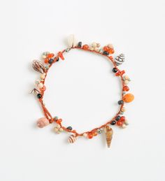 Crocheted silk bracelet with shells, bamboo, wood, coral, agate and turquoise beads