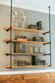 Fixer upper season 2 - reclaimed shelves, industrial style pipes, cotton, glass bottles and old books.