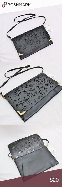 """NWT H&M Black Laser Cut-Out Clutch/Crossbody Purse This cute purse is NEW WITH TAGS! It has a fun paisley print cut out of the front flap. The dimensions are 12"""" x 8"""" with a detachable 41"""" strap. Under the flap it zippers shut, it has one zipper pocket on the inside. It's 100% polyester, but looks like leather. Reasonable OFFICIAL Offers may be considered :) H&M Bags Crossbody Bags"""