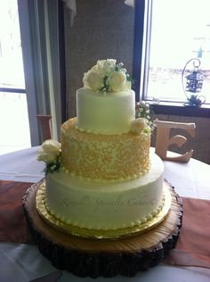 Rowell's Specialty Cakes White and gold wediing cake gold lace wedding cake