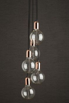 Copper Cluster Pendant Light with retro bulbs in copper holders. A modern light with a vintage edge, black cables hang from a copper fitment. Oozes class and style