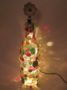 Wine bottle lamp with flower topper