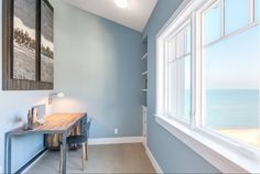 This soothing blue paint color is Benjamin Moore Santorini Blue.