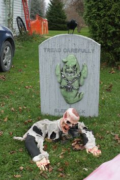 I created the sleepwalk tombstone last year. I found a cheapo ghost with light up eyes and glued it on.