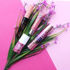 A bouquet of pretty #fotd faves! Roller lash for super curled lashes, girl meets pearl primer for subtle sheen, lollitint for a pop of orchid on our cheeks, and hervana ultra plush gloss for smooch worthy lips, muah! #benefit