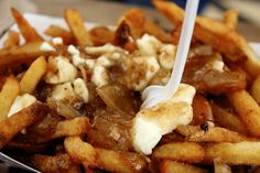Poutine (french fries, gravy, and cheese curds) at Potato Champion in Portland, Oregon.  Yummmmm!