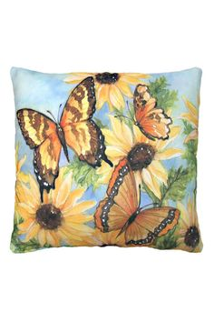 Three colorful butterflies and a gathering of golden black eyed susans are set against a blue sky in this indoor/outdoor pillow printed from a watercolor painting by artist Sally Eckman Roberts. Made of 100% polyester, this pillow is fade and mildew resistant and has the soft feel of cotton. Perfect for your porch or patio! Removeable zippered cover is machine washable.    Measures 18 x 18 inches.   Butterflies Blossoms 2 Pillow by Magnolia Casual. Home & Gifts - Home Decor - Pillows…