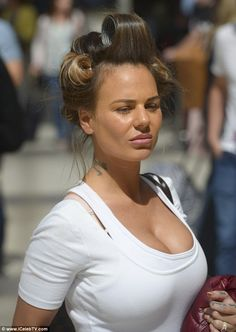Hair-raising: Sporting a head full of rollers, the 26-year-old reality starlet seemed in g...
