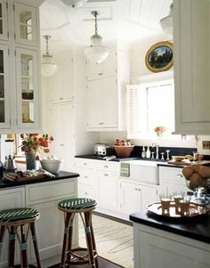 I live in an old building with high ceilings and high cabinets. I prefer this, since I feel short cabinets are both nasty dirty and greasy and a total waste of space. Even at 5ft tall, I would rather use a step ladder and standing on the counter than not have these upper spaces!