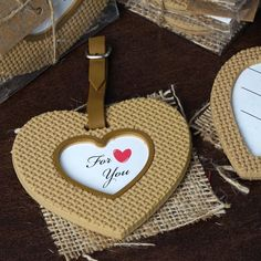 Burlap Heart Frame Favor | eFavorMart /  Show your hearty appreciation and acknowledgment to your guests for sharing your special day with you by presenting this heart-touching favor. The natural tone burlap accent will add a spectacular classic rustic touch to your ceremony, and will make a durable, yet elegant relic to be shared and cherished. The silicon heart shape favor with a heart shaped opening will show your guests that your gratitude came straight from the heart. The love note For…
