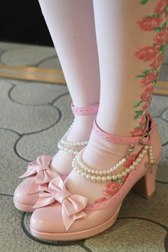 Pink shoes and pearls.