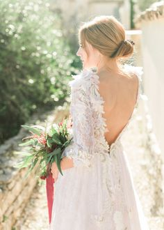 Elegant deep backless wedding dress: Photography : Adrian Wood Photography Read More on SMP: http://www.stylemepretty.com/destination-weddings/2017/02/07/a-dream-dress-and-greece-make-for-the-most-beautiful-combo/