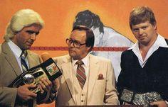 NWA World's Heavyweight Champion The Nature Boy Ric Flair and WWWF Champion Bob Backlund with Gordon Solie