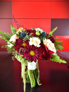 Dahlias, sword fern, thistle, seeded eucalyptus, amaranths, astilbe, and so much love! What a bouquet!