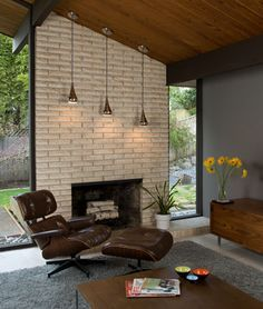 basement: fireplace surrounded by floor/ceiling windows.