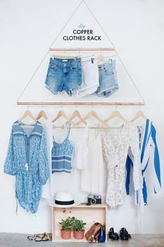 DIY copper hanging clothes rack.  Super cute idea for displaying your favourite pieces of clothing!