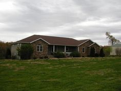 The one you've waited for! This incredible 4BR/3BA executive home has the best of everything! Country living close to town, this is across the road from a golf course on 4 acres with pond and shop. The home has tons of top shelf features: Master bedroom suite, Andersen windows and doors, gorgeous hardwood floors, heated and cooled oversize garage, interior insulation package, tankless water heater, central vac, security system, water softener, dual fuel heat, above ground pool, two decks…