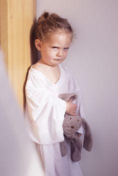 Little girl sulking in corner by photoalto
