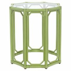 """With a geometric openwork silhouette and kiwi-hued finish, this glass-topped rattan end table pairs natural style with vibrant appeal.     Product: End table   Construction Material: Rattan, leather, and glass   Color: Kiwi    Features:  Leather-wrapped rattan pole0.25"""" Thick inset tempered glass top   Dimensions: 22"""" H x 19.5"""" W x 19.5"""" D   Cleaning and Care: Wipe with damp soft cloth with light soap"""