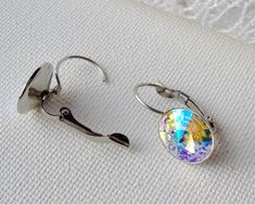 AB Crystal glacier blue rhinestone leverback earrings / aurora borealis / Surgical steel / Hypoallergenic earrings / Swarovski / gift for her This color is similar to aurora borealis, with a bit more blue/purple flash. Swarovski crystal rhinestones set in surgical stainless steel
