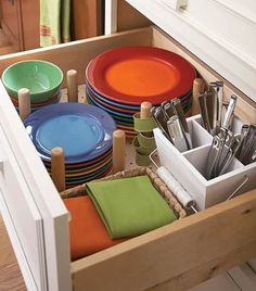 Dish Drawer    Instead of lifting plates high onto upper cabinets, keep them low. Keeping silverware, napkin rings, and cloth napkins in the same drawer makes table setting a snap.: