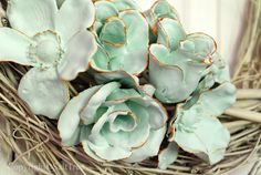 silk flowers dipped in plaster of paris, colored with a little tempera powder, finished with a little metallic paint  Look like succulents!