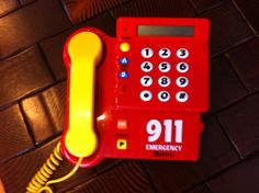 """Brings back memories from our youth! However, this new version lets you record your own voice and teaches your #child how to dial """"911"""" in case of an emergency! #toy #phone #kids"""