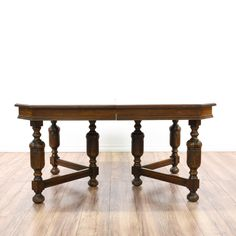 This dining table is featured in a solid wood with a glossy walnut finish. This Spanish Renaissance Revival style kitchen table has carved ball-turning legs, 3 expandable leaves, and carved trim. Perfect for formal or casual dining! #european #tables #diningtable #sandiegovintage #vintagefurniture