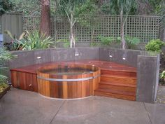 love how the hot tub is sunk in the deck and could be built into the retaining walls-- would do a regular hot tub though