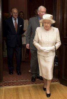 Queen Elizabeth II and Prince Phillip, Duke of Edinburgh (L) during a visit to the Journalists' Charity at the Stationers' Hall, 07.05.2014 in London, England.