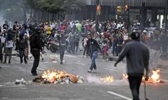 Protesters clash with police in the Venezuelan capital, Caracas, on the anniversary of last year's violent unrest